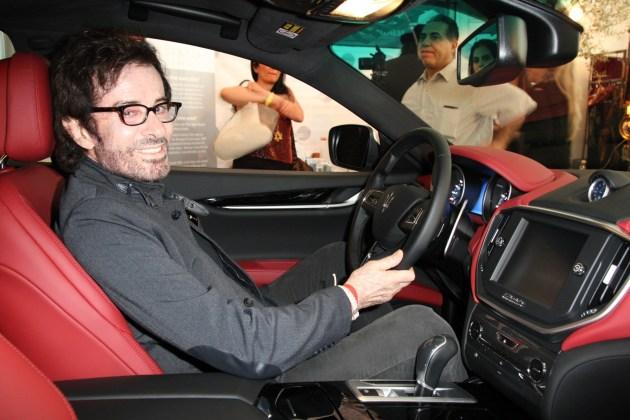 Oscar winner George Chakiris loving the feel of the Maserati, sponsor of the Valentine Romance Style Lounge