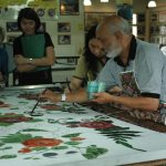 Man Doting Batiks by Hand - Indonesia