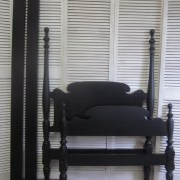 Black twin poster bed
