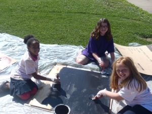 Leo E. Solomon-Plains 6th Grade Elementary Students painting one of the Solar Kiln doors.