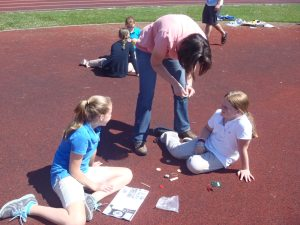 Ann Devine-PA DEP EE Coordinator working with students to help them build their solar powered race cars.