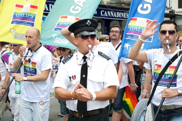 Pride Brighton [parade. Prison Service officers, walking down the road ti with banners