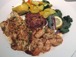 Broiled seafood platter with mixed vegetables.