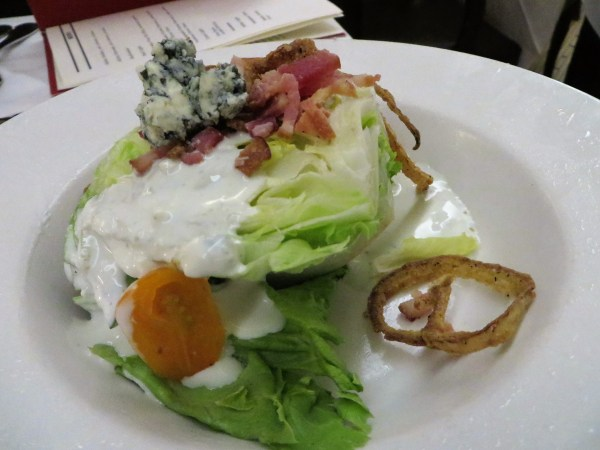 Wedge salad with bleu cheese and fried onions.
