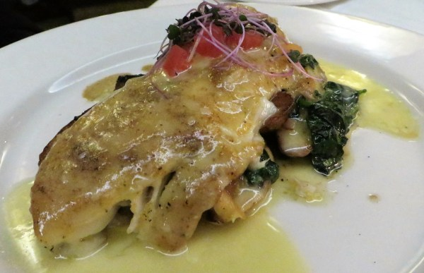 Black Drum over potatoes and kale.