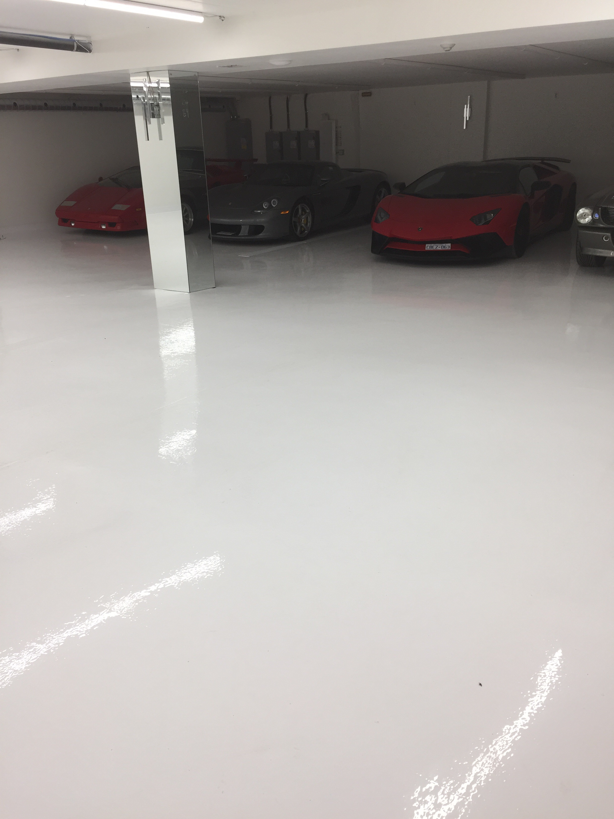 Epoxy Garage Floor Toronto White Epoxy Floor For Exotic Car Garage In Thornhill Epoxyguys