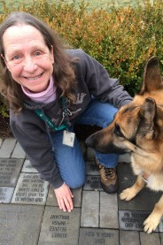Photo of Sue Martin and her seeing-eye dog Quan
