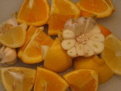 Garlic, Oranges, and  Lemon Wedges