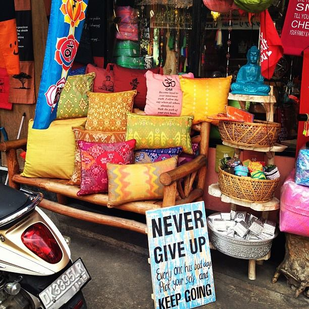 Om pillow and never give up sign!