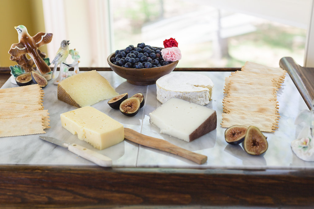 Spring Cheese Board with Vintage Figurines