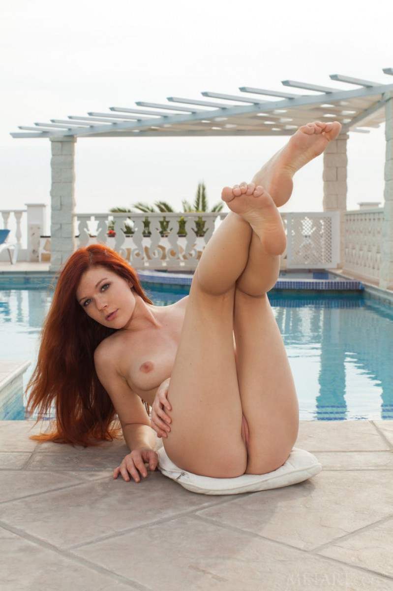 Mia Sollis Strips by the Pool