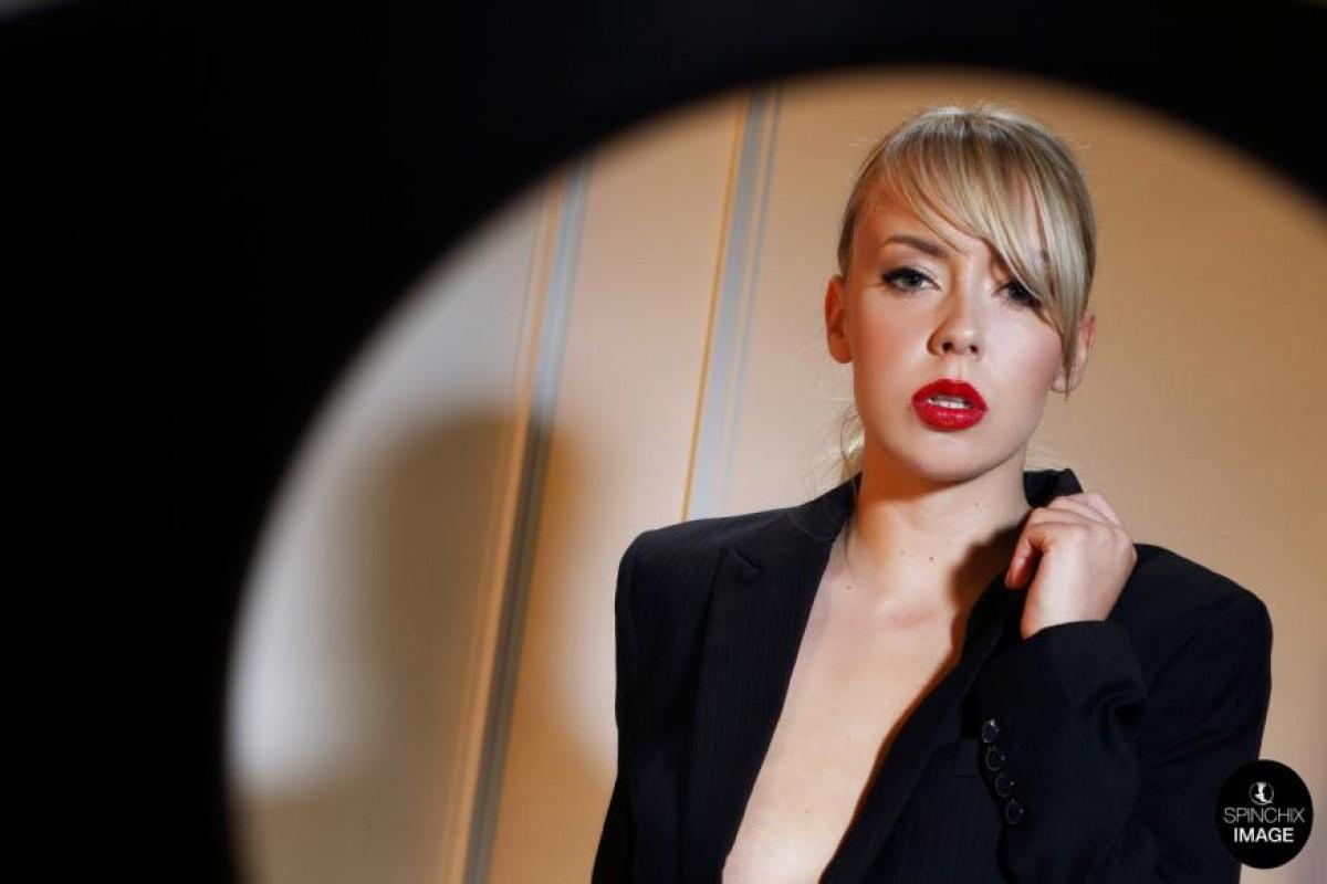 Topless Blonde in a Black Blazer