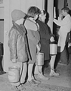 Great Depression: Children waiting in line for soup given out each night by the city mission, a community chest- financed organization. Dubuque, Iowa. Photo by John Vachon. Courtesy Library of Congress, Prints & Photographs Division, FSA-OWI Collection LC-USF34- 060600-D
