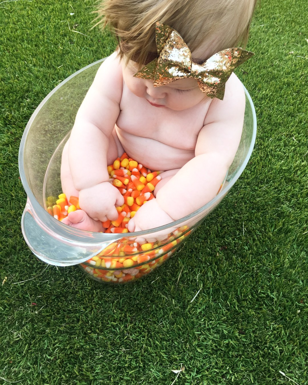 Cute photo ideas with candy corn! Our candy corn photo shoots is a scrumptiously adorable tradition that our family will always remember.