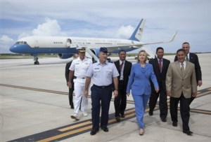 U.S. Secretary of State Hillary Rodham Clinton, in blue, walks with Guam Governor Felix Camacho, right, after arriving at Andersen Air Force Base Friday, Oct. 29, 2010 in Guam. (AP Photo/Evan Vucci, Pool)