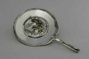 Mirror Decorated with Cupids. Silver. MANN 12607. ©The Superintendence for the Archaeological Heritage of Naples (SAHN).