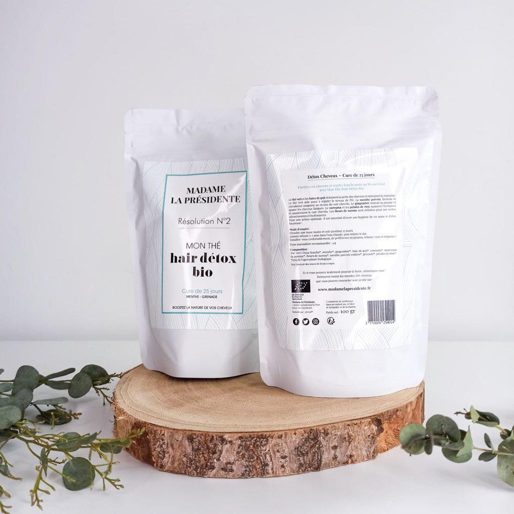 Deux packets de thé : un de face et un de dos avec les ingrédients