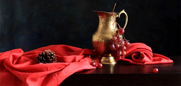 copper pot and grapes