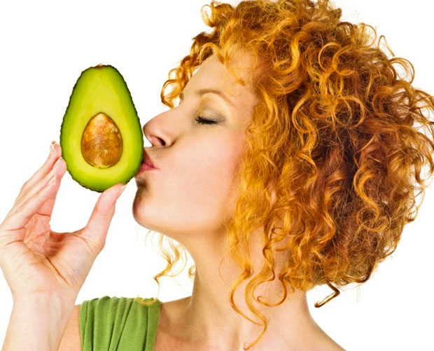 woman kissing avocodos