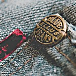 Closeup of Copper Rivet on Jeans CC BY Marcus Andre