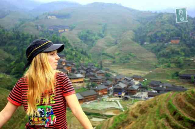 A girl is exploring Longji Terraced Fields in Guangxi Province