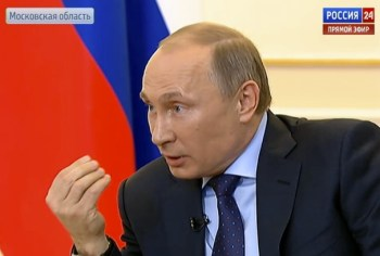 Russian President Vladimir Putin at a news conference at the Novo-Ogaryovo state residence outside Moscow, on March 4, 2014.