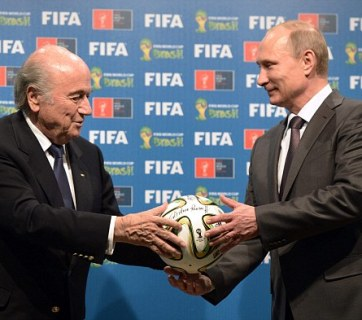 Then FIFA President Joseph Blatter and Russia's President Vladimir Putin pose during handing over of the 2018 FIFA World Cup signed certificate to Russia. (Image: Alexei Nikolsky/AP/RIA Novosti)