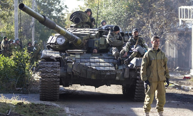 Russian occupation troops on a tank get ready to take position near Donetsk airport during fighting with Ukrainian defenders in the town of Donetsk, eastern Ukraine, October 4, 2014. (Image: REUTERS/Shamil Zhumatov)