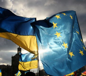 Ukrainian and EU flags fly above Maidan Nezalezhnosti square in  Kyiv, Ukraine, during the Euromaidan revolution. Photo from EPA/ Zurab Kurtsikidze