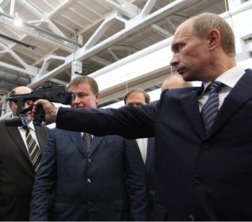 Putin with a fully automatic pistol