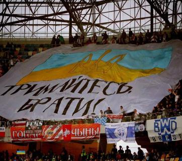 "Belarusian football fans holding a giant banner that says: ""Stay Strong, Brothers!"" during the match of Ukraine and Belarus national teams on September 5, 2015, in Lviv, Ukraine (Image: social media)"