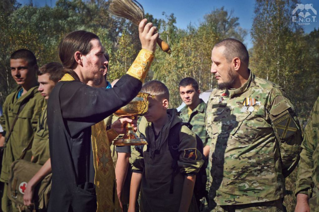 "The instructors and trainees of the mercenary camp were ""blessed"" by a Russian Orthodox monk from the monastery in whose territory the camp is located. Moscow oblast, Russia, September 2015 (Image: ENOT Corp)"
