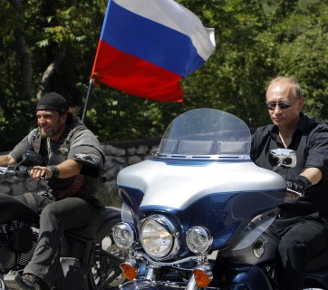 Putin riding a 3-wheel motorcycle