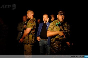 "Alexander Boroday and other leaders of, self-proclaimed ""Donetsk People's Republic"" at the MH17 Crash Site, July 17, 2014"