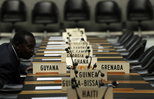 A delegate waits for the opening of a session of the Trade Negotiation Committee at the WTO in Geneva, July 22, 2013. (Denis Balibouse/Courtesy Reuters)
