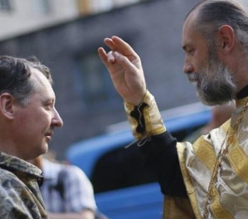 "A priest blesses Igor Strelkov, a self-described Russian nationalist and imperialist, organizer of the ""DNR"""