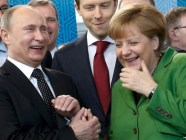 Vladimir Putin and Angela Merkel at a trade fair in Hanover, April 2013. Photo: Reuters