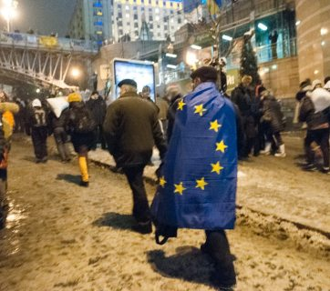 A Ukrainian protester wrapped in the EU flag during the pro-European revolution on Kyiv Maidan, 2014. Photo by: Maksim Belousov