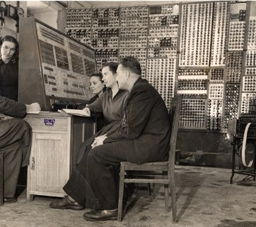 Small Electronic Calculating Machine (Russian: MESM). On the picture (left) is Lev Naumovich Dashevskiy, next to him - Zoya Sergeevna Rapota. At the board are Lidiya Mikhailovna Abalyshnikova, Tamara Ivanovna Petsukh and Yevgeniy Evgenyievich Dedeshk