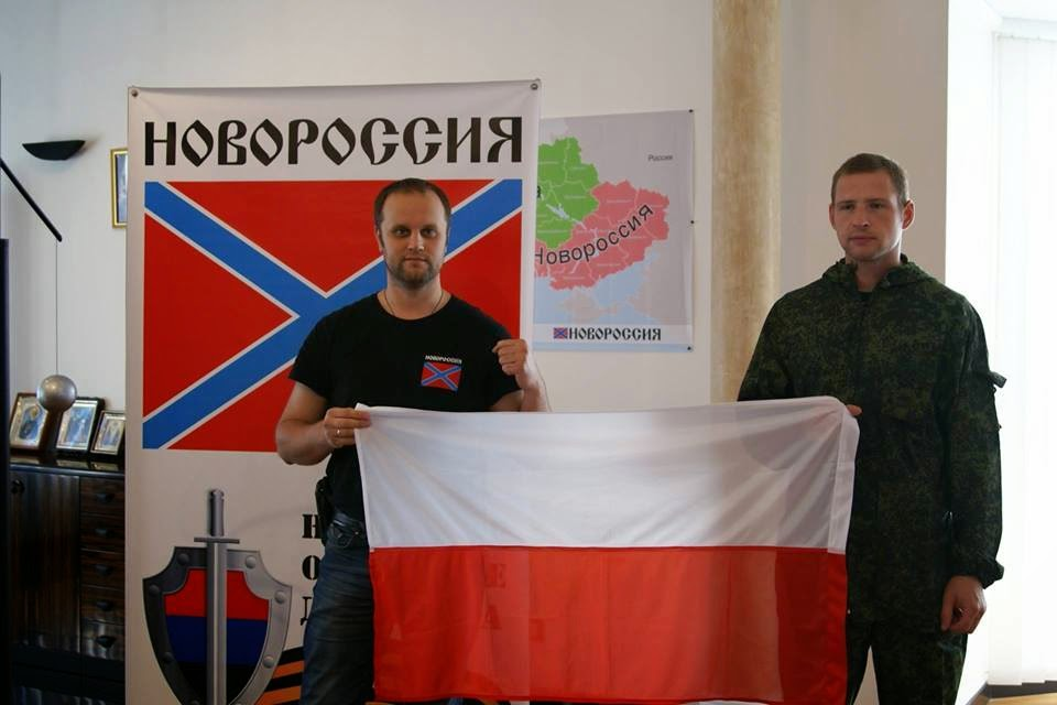 "Dawid Hudziec with the flag of ""Novorossiya"" and Polish flag, photo from правдинформ.рф"