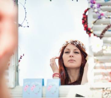 Woman trying on jewelry at Made in Ukraine local producers' festival in Kyiv, Ukraine on 4-5 June 2016. Photo from Made in Ukraine fb page