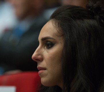 Crimean Tatar singer Jamala watching the documentary with tears photo: president.gov.ua