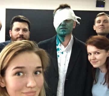"Alexei Navalny, a prominent Russian opposition figure, with his staff after he has been attacked with a chemical mixture containing ""brilliant green"", a strong alcohol-based die used as an antiseptic, for the second time this year. The politician lost 80% of vision in his right eye as of April 30, 2017. (Image: @navalny)"