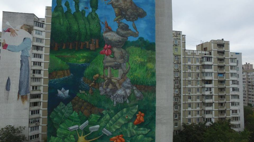 Author: Dima Fatum The huge wall tells a surreal picture-story about the historical and contemporary context of the Kharkiv neighbourhood, the second-largest city in Ukraine. The composition is filled with a variety of Ukrainian traditional characters, each of which illustrates this area.