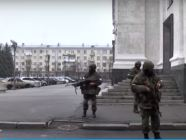 "Masked ""little green men"" in downtown Luhansk. 21 November 2017. Screenshot: Youtube"