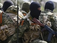 Armed militants in Donbas wearing St. George's ribbons