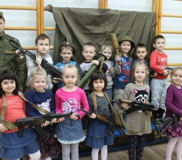 "Russian kindergarten children holding Kalashnikov assault rifles, grenades and grenade launchers after a ""patriotism"" lesson in St. Petersburg, Russia, February 2015 (Image: social media)"