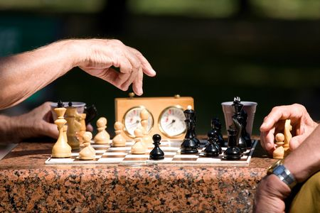 5689175 - chess board and hands of people in details
