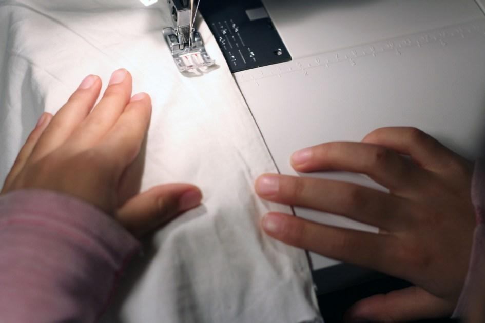 første søm på symaskin