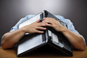 depressed computer covering head